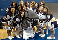 Photo of cheerleaders with mascot. Link to Gifts by Estate Note.